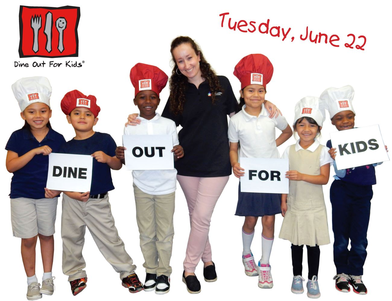 Site Coordinator and little kids in chef's hats holding Dine Out For Kids signs